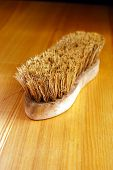 pic of olden days  - Old Worn Scrubbing Brush on a New Oak Table - JPG