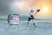 foto of ice hockey goal  - Ice hockey player on the ice - JPG