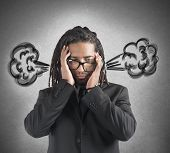 picture of stress  - Businessman stressed with the brain in smoke - JPG