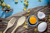 picture of duck egg blue  - Still life broken white eggs and egg yolk on a wooden rustic background - JPG