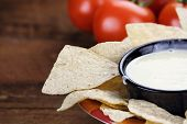 foto of dipping  - Queso Blanco or White Cheese Sauce with corn tortilla chips and fresh tomatoes - JPG
