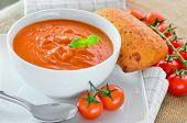 stock photo of bread rolls  - Fresh Tomato Soup And Fresh Baked Crusty Bread Rolls - JPG