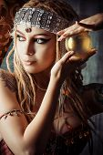 stock photo of witch ball  - Magnificent fortune teller holding crystal ball - JPG