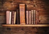 pic of book-shelf  - grunge wooden shelf with old books - JPG