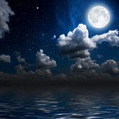 stock photo of reflection  - moon on a background star sky reflected in the sea - JPG