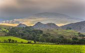 foto of rain cloud  - Rain clouds moving in over the Snowdonia mountains in Wales  - JPG