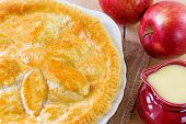 image of custard  - Whole Apple pie with a jug of custard selective focus - JPG