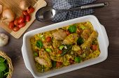 pic of curry chicken  - Roasted chicken quarters with curry vegetables cauliflower tomatoes and leek - JPG