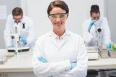 picture of scientist  - Happy scientist smiling at camera with protective glasses in the laboratory - JPG