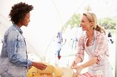 picture of marquee  - Woman Selling Fresh Cheese At Farmers Food Market - JPG