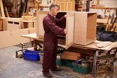 foto of work bench  - Carpenter Building Furniture In Workshop - JPG
