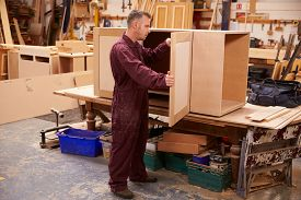 pic of joinery  - Carpenter Building Furniture In Workshop - JPG