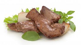 stock photo of liver fry  - Fried pieces of beef liver with fresh green lettuce basil and fried onion on the white - JPG