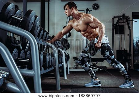 Poster Of Strong Muscular Bodybuilder Doing Exercise In The Gym Part Fitness Body
