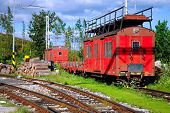 stock photo of chug  - red freight train in the mountains scenery - JPG