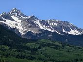stock photo of rocky-mountains  - The Rocky Mountains of Colorado rising high into the blue skies
