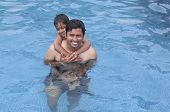 picture of family fun  - Father and Son having fun at  the resort pool - JPG