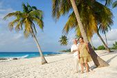 Happy senior couple embracing each-other and enjoying retirement on tropical destination: Maria la Gorda beach on caribbean island Cuba poster