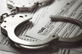 Tax Evasion And Avoidance Concept. Tax Form And Handcuffs poster