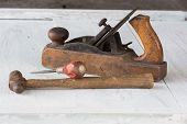 Close-up Shot Of Collection Of Antique, Weathered Vintage Tools, Hammer, Awl And Wooden Block Plane, poster