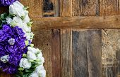 Purple And White Contrasting Flowers Placed On Wooden Surface. poster
