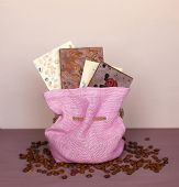 Chocolate Bar In A Pink Sack On A Purple Background And Coffee Beans. Chocolate. Chocolate Bar. Nut  poster