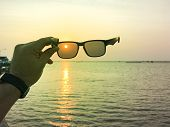 Sea Landscape Through Sun Glass Lens In Sunset, Yellow Light Of Sunset On Sea, Beautiful Sky Of Suns poster