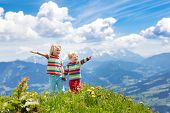 Children Hiking In Alps Mountains. Kids Outdoor. poster