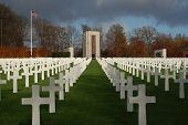 Monument And Crosses In Luxembourg American Military Cemetery poster