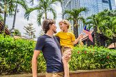 Father And Son Travelers In Malaysia With Malaysia Flag Celebrating The Malaysia Independence Day An poster