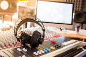 Radio Station: Headphones On A Mixer Desk In An Professional Sound Recording Studio poster