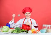 Woman Professional Chef Hold Spoon With Raw Mushroom. Dieting Concept. Girl Wear Hat And Apron Try M poster
