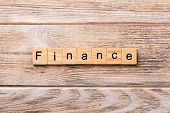 Finance Word Written On Wood Block. Finance Text On Wooden Table For Your Desing, Concept poster