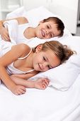 Happy morning lazing kids in bed