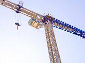 Self-erecting Crane. Construction Crane Against The Sky. Close Up. Construction Site Background. poster