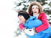 picture of asian woman  - Winter couple piggyback in snow smiling happy and excited - JPG