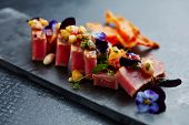 Seared tuna with garnish poster