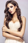 Make Up. Glamour Portrait Of Beautiful Woman Model With Fresh Makeup And Romantic Hairstyle. poster