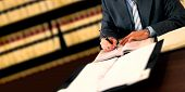 image of law-books  - Lawyer working at his desk in the office - JPG