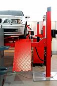 picture of car repair shop  - Auto service garage with car at lift - JPG