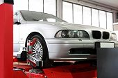 stock photo of auto garage  - Auto service garage with car at lift - JPG