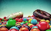 stock photo of gumballs  - donuts and gumballs isolated on blue background - JPG