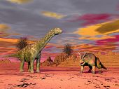 stock photo of prehistoric animal  - Two prehistorical animals in the desert by cloudy sunset - JPG