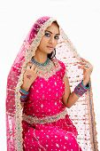 stock photo of bangla  - Beautiful Bangali bride in colorful dress and veil isolated - JPG