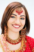 stock photo of bangla  - Beautiful Bangali bride in colorful dress isolated - JPG