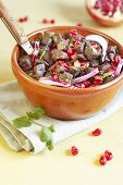 stock photo of giblets  - Hot salad from beef giblets with pomegranate grains onions and coriander - JPG