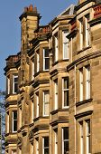 stock photo of tenement  - A block of traditional sandstone tenement flats from Edinburgh Scotland - JPG