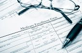 picture of medicare  - Medicare insurance form with glasses and pen - JPG