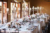 pic of crockery  - Hall at a wedding reception with decorated tables