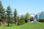 stock photo of burlington  - A typical American backyard with child playground during a sunny day - JPG